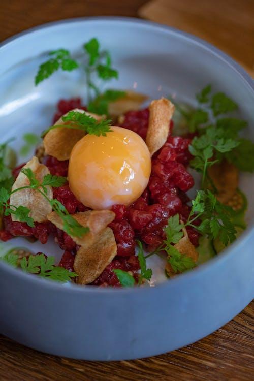 Tartare dish with raw egg
