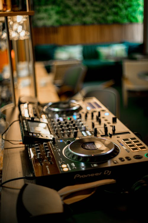 DJ controller mixer console in television studio