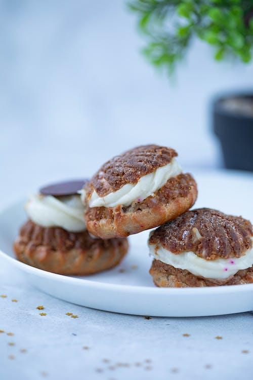 Delicious choux au craquelins on white plate