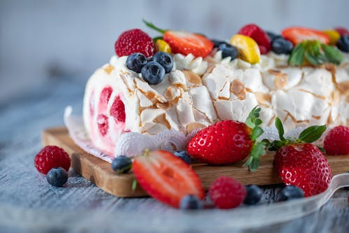 Sweet dessert with ice cream decorated with fresh strawberries