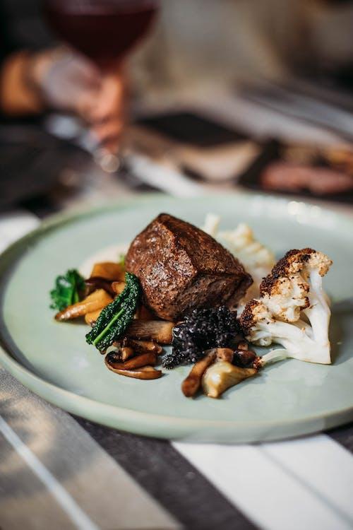Gratis stockfoto met avondeten, bestek, bord