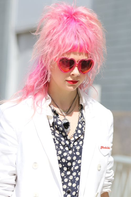 Woman with Pink Hair Wearing White Blazer