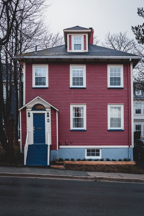 Old residential house with colorful walls