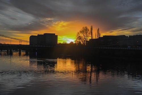 Free stock photo of bridge, bright, buildings, clouds