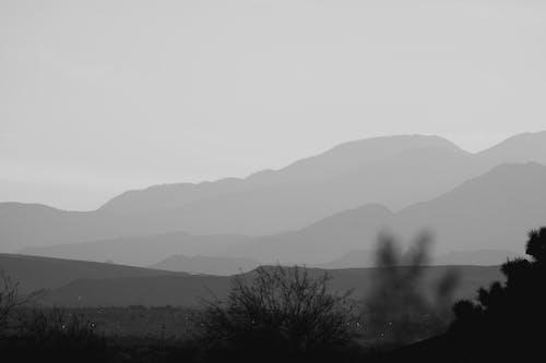 Black and White Mountain Under White Sky