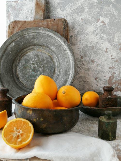 Orange Fruits on Round Gray Concrete Bowl