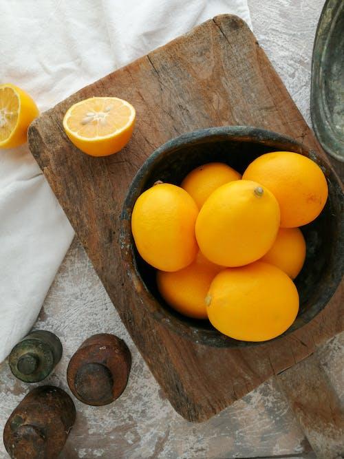 Orange Fruits in Brown Wooden Bucket