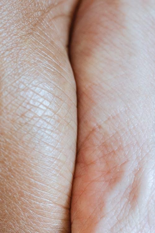 Hands of faceless multiracial couple