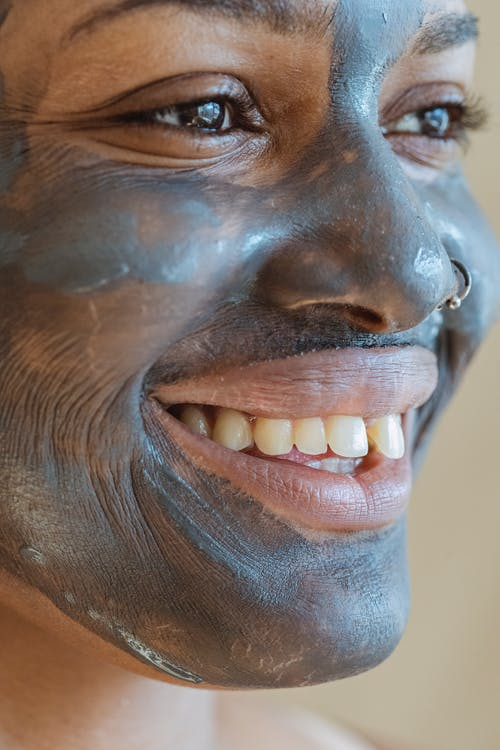 Black woman with purifying mask on face