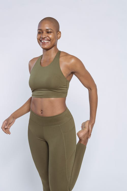 Woman in Gray Sports Bra and Gray Leggings