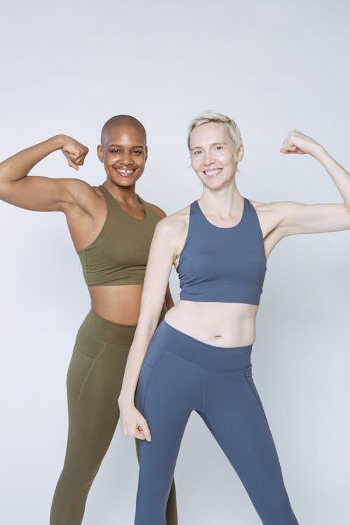 2 Women in Blue Sports Bra and Blue Leggings