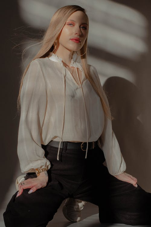 Woman in White Long Sleeve Shirt and Black Pants