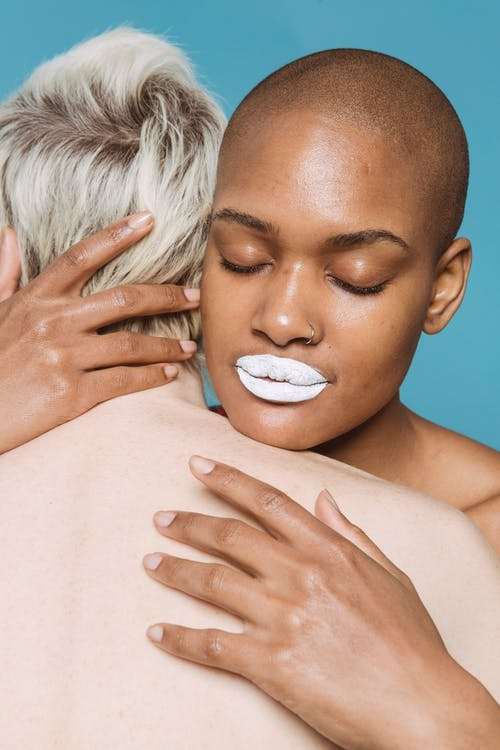 Topless Woman With White Cream on Face