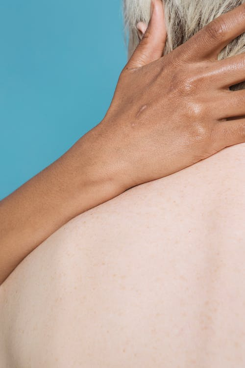 Persons Hand on Top of Her Stomach
