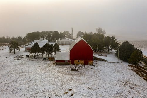 Red and White Wooden House on Snow Covered Ground