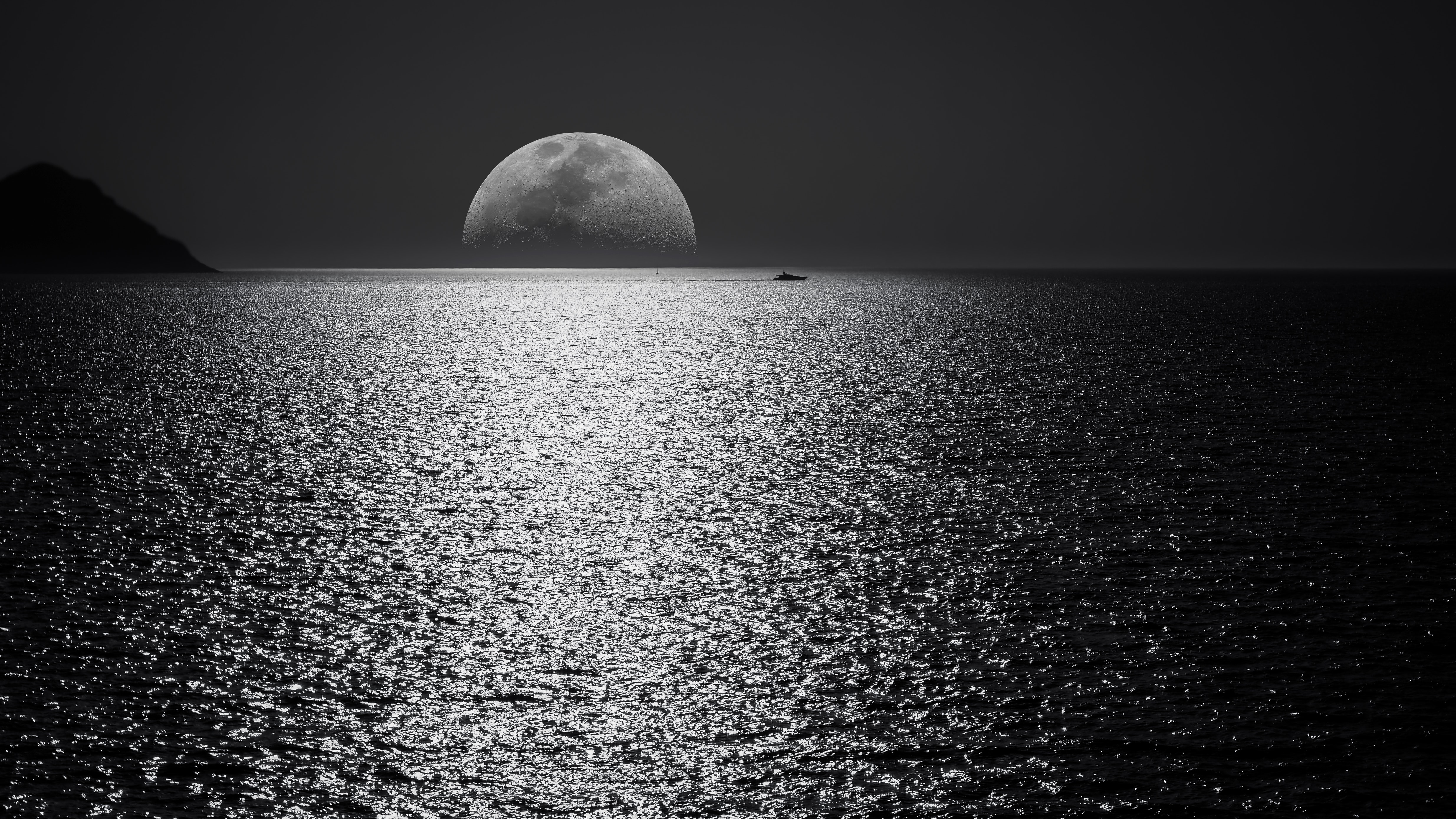 White and black moon with black skies and body of water photography during night time george desipris