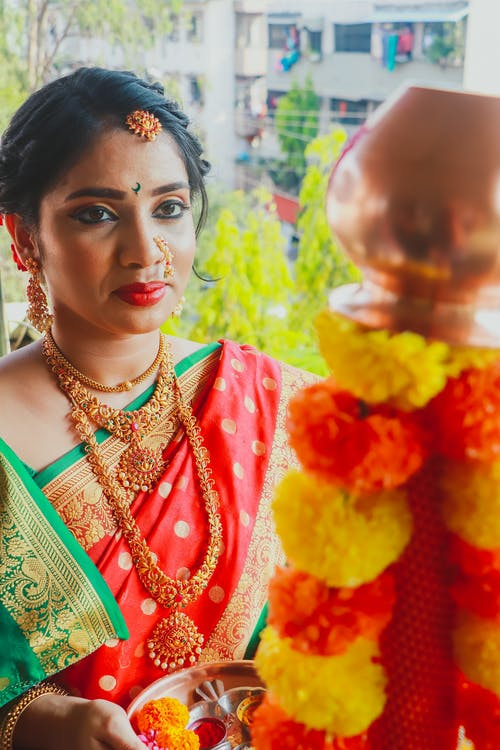 Woman in Green and Red Floral Sari
