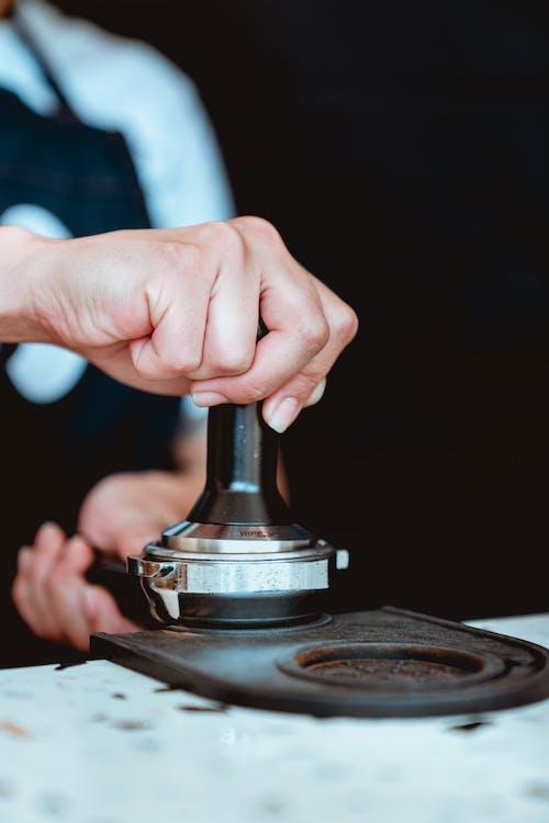 Photo of Person Preparing Coffee