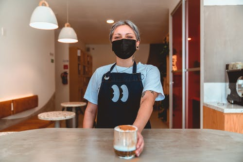 Photo of Barista Serving Iced Coffee