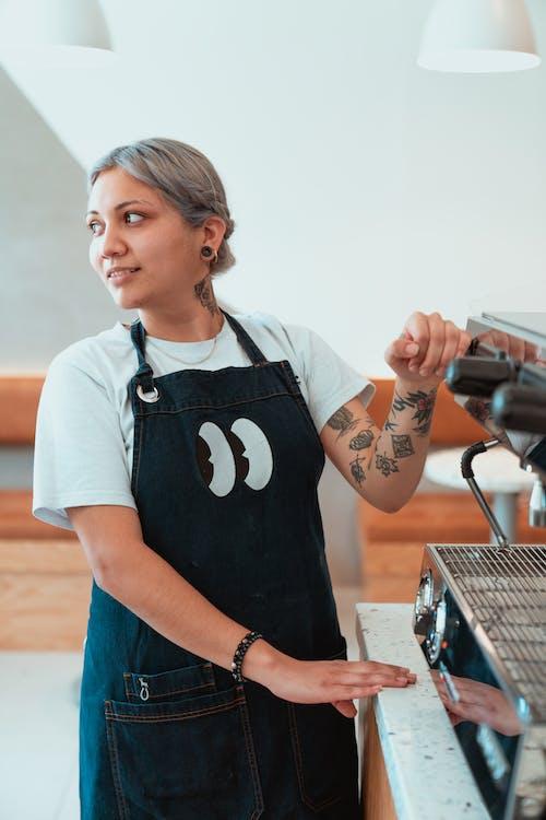 Photo of Female Barista Beside Espresso Machine