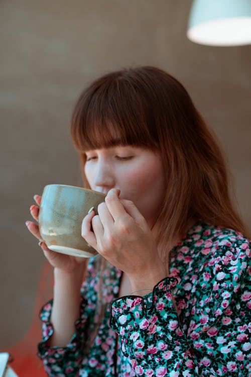Photo of an Attractive Woman Drinking Coffee