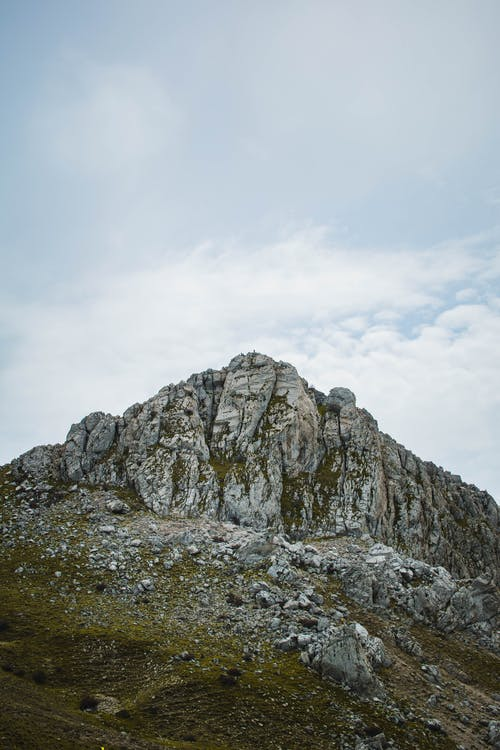 Gray Rocky Mountain Under White Cloudy Sky