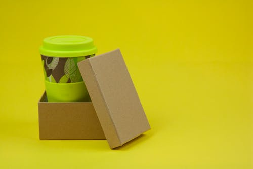 Paper cup in cardboard box