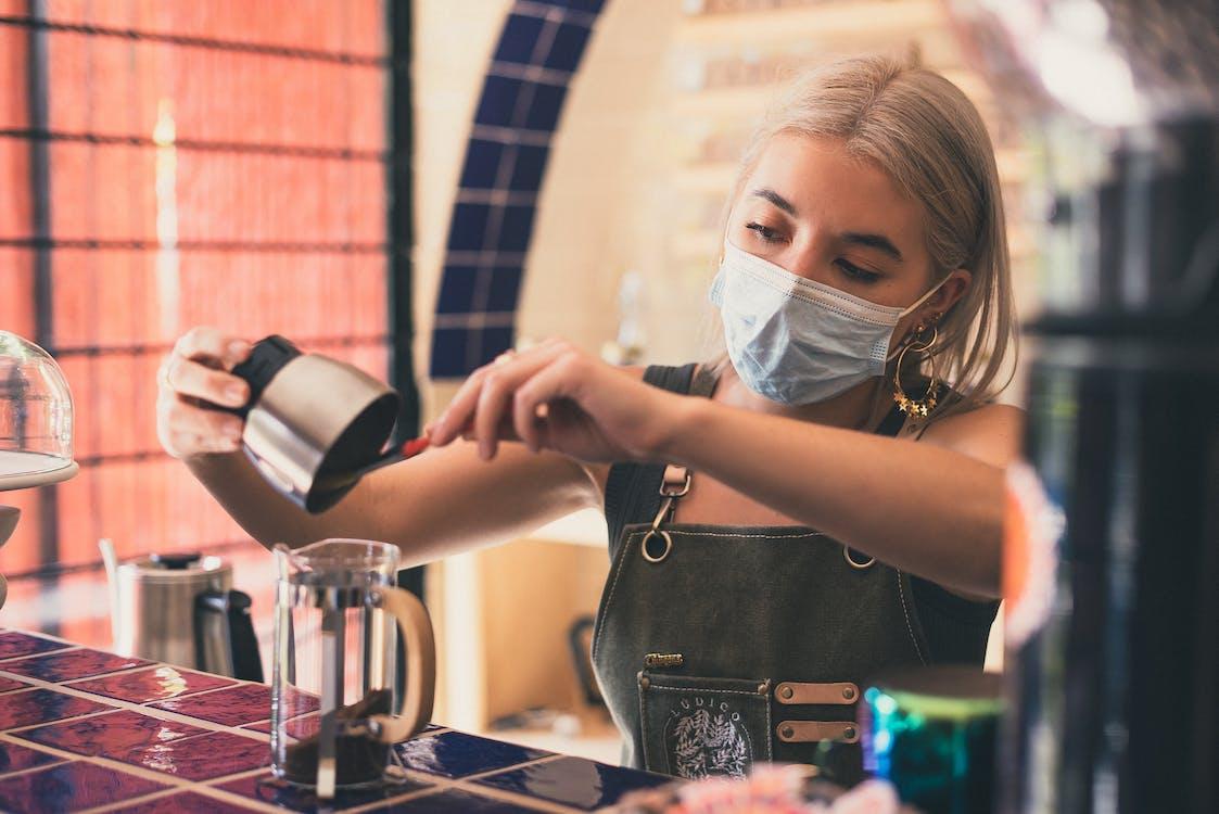 Photo of Woman Preparing Coffee Drink