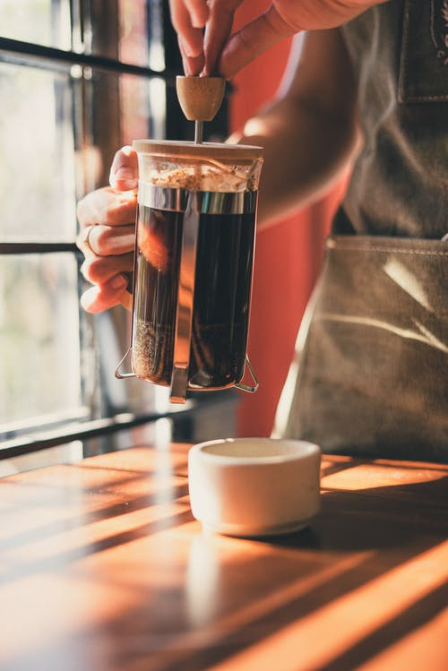 Photo of Person Using French Press