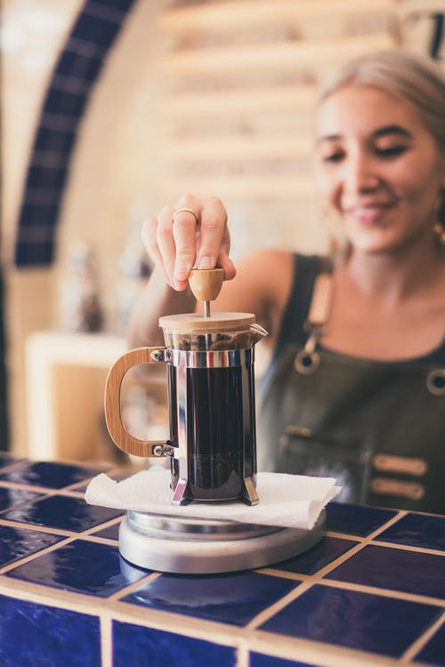 Photo of Woman Using French Press
