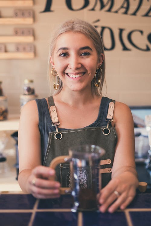 Photo of an Attractive Woman Holding French Press
