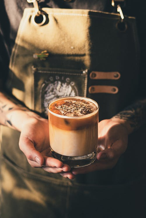 Photo of Barista Holding Iced Coffee