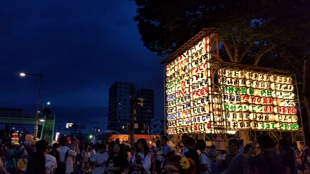 Group of People Near Multicolored Lantern Display