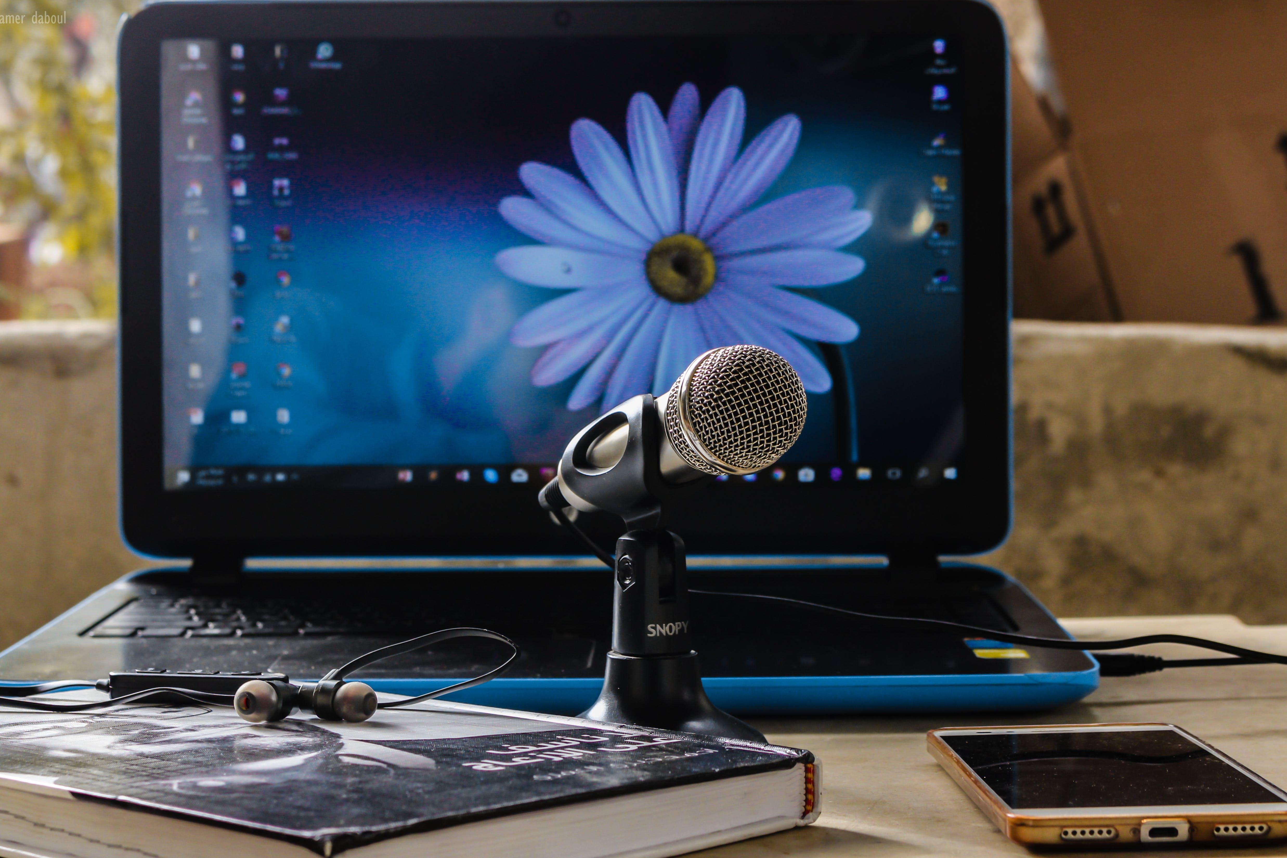 Microphone Near Blue Laptop