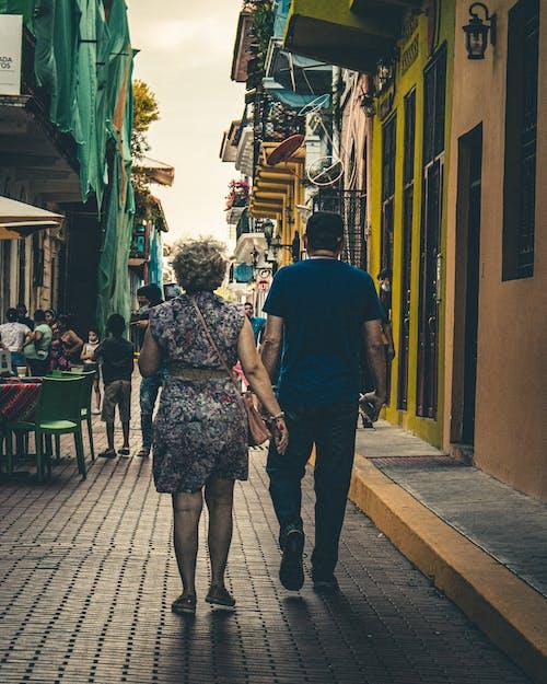 A Couple Walking on a Street