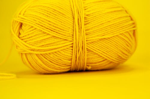 Colorful skein on yellow surface