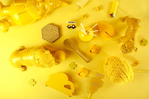 Different yellow decorations on yellow surface