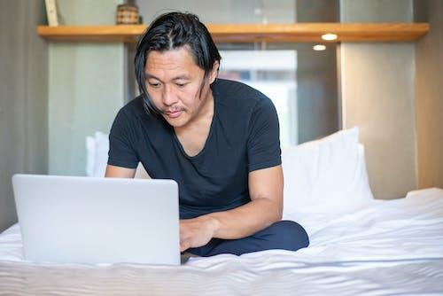 A Man Using a Laptop
