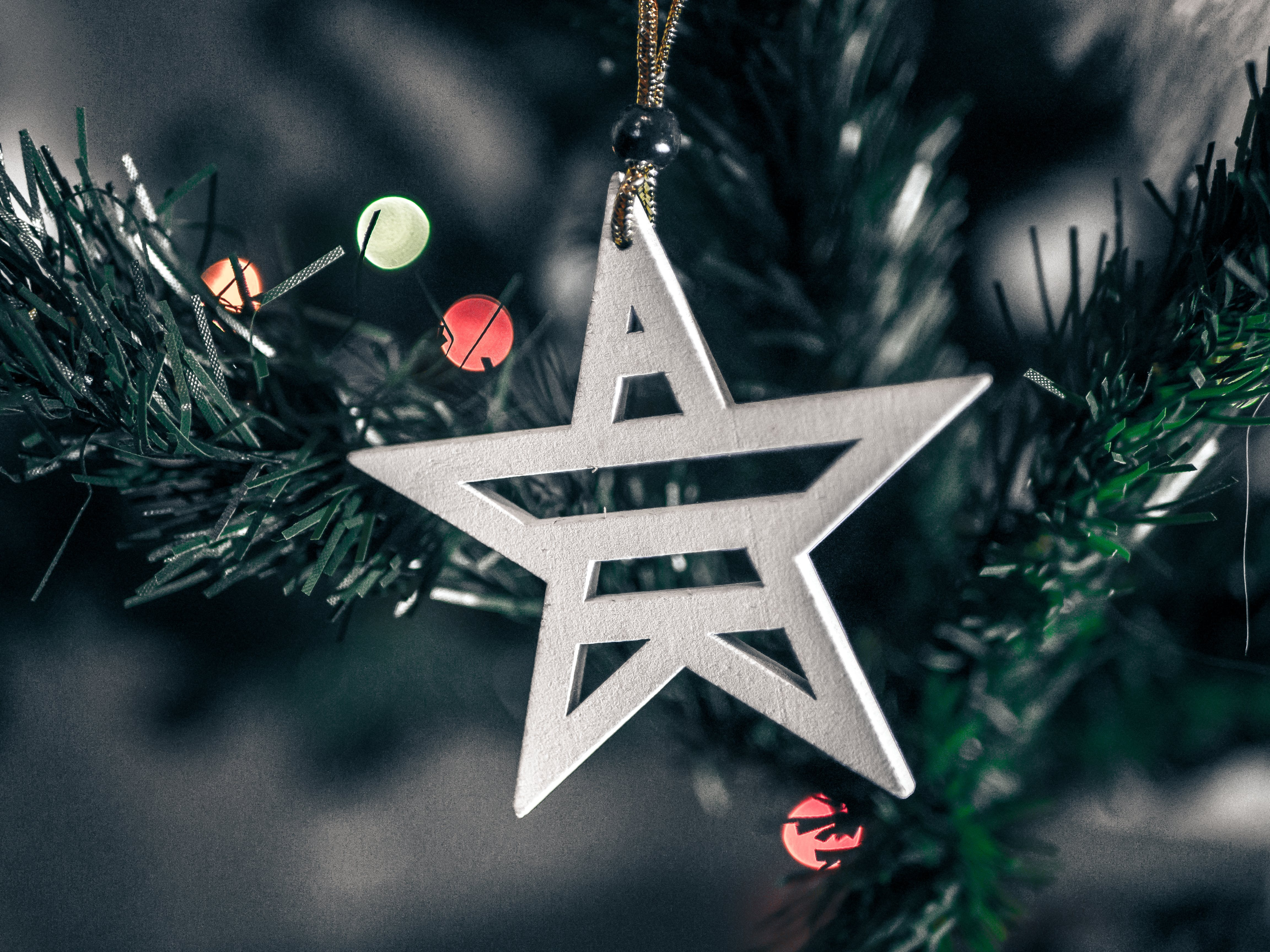 Macro Shift Photography of White Wooden Star Christmas Decor