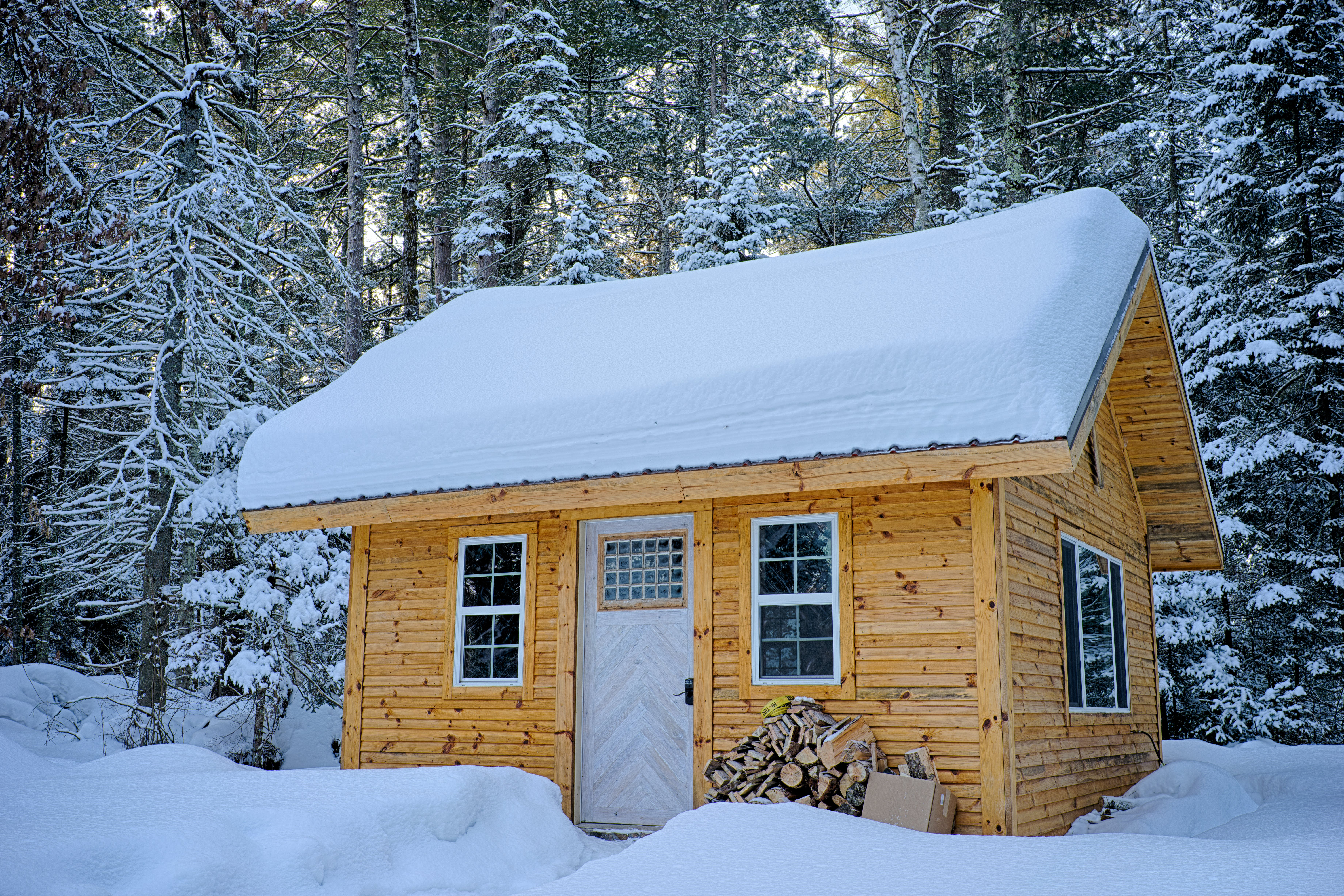 Snow Covered Wooden House Inside Forest