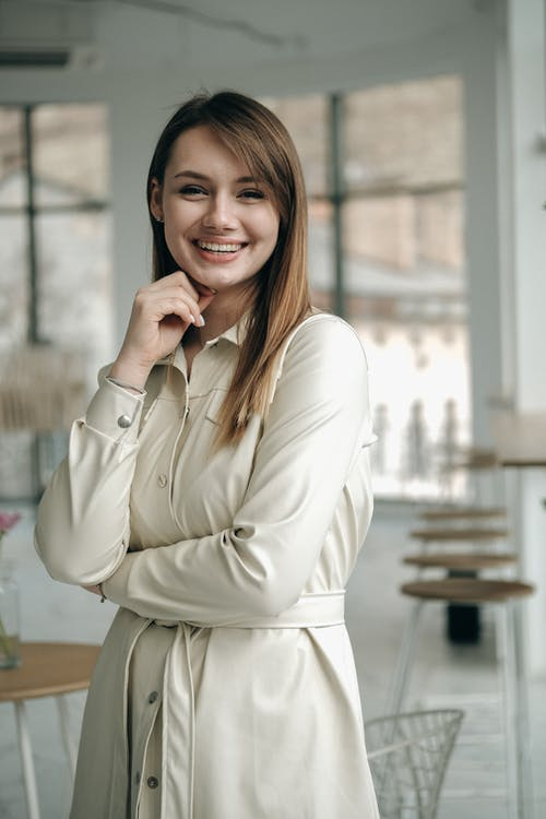 Smiling woman standing in modern cafe
