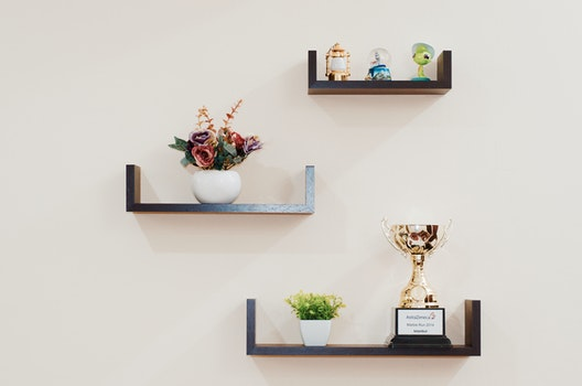 Brown Wooden Floating Shelves Mounted on Beige Painted Wall
