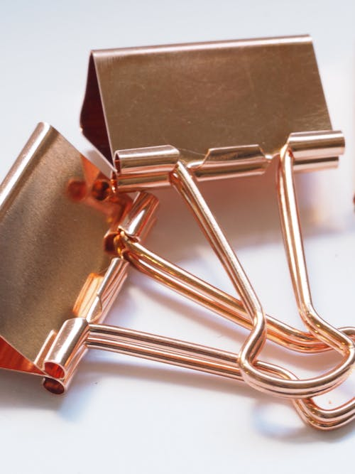 Two Gold Binder Clips