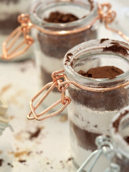 Cocoa powder with powdered sugar in glass jars