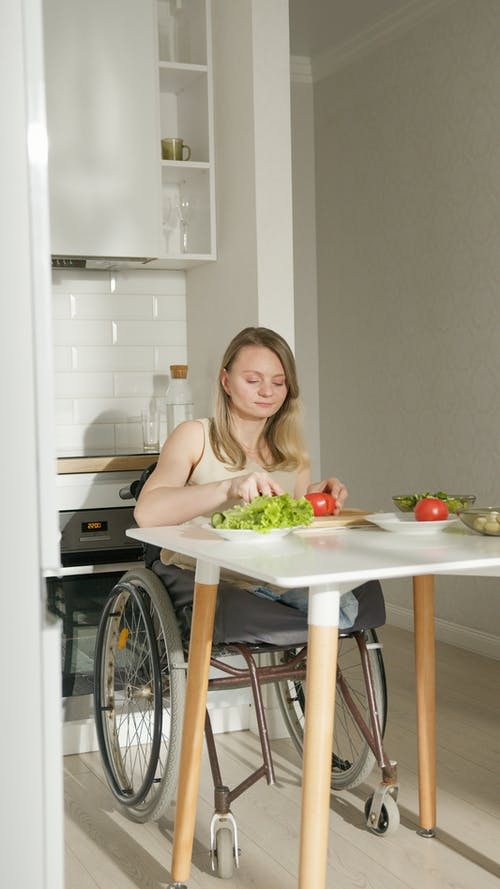 A Woman Cutting Vegetables in the Kitchen