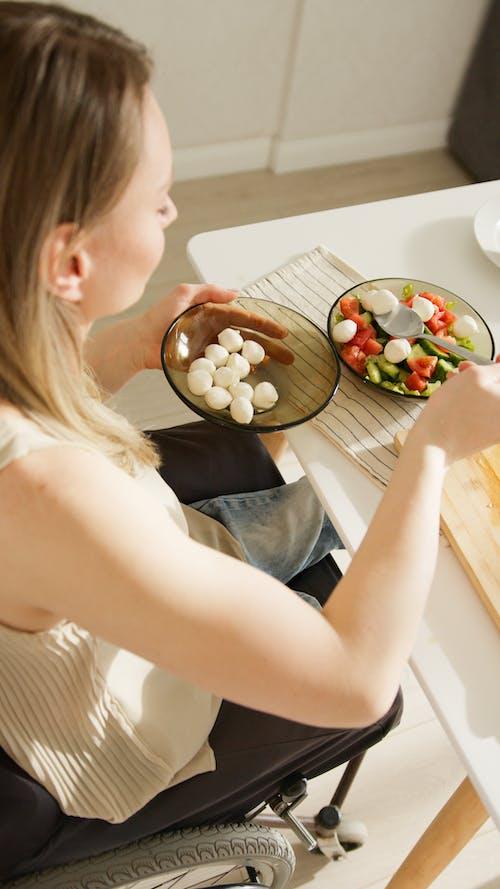 A Woman Preparing a Salad