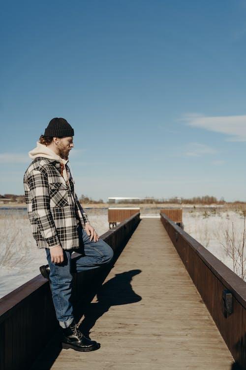 A Man Standing on the Boardwalk