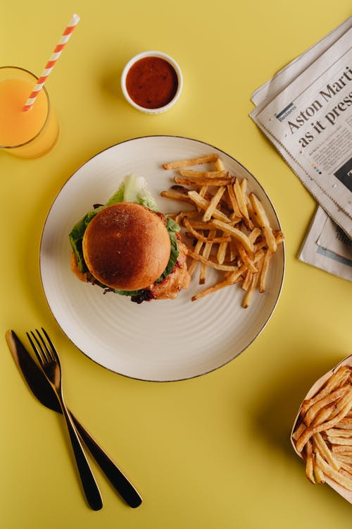 Burger and Fries on White Ceramic Plate