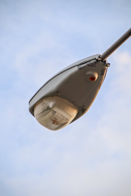White and Black Lamp Under Blue Sky