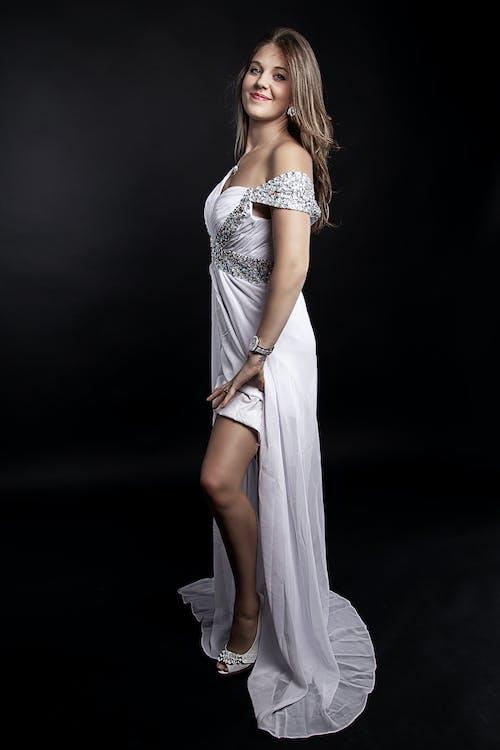 Woman in White Dress Posing